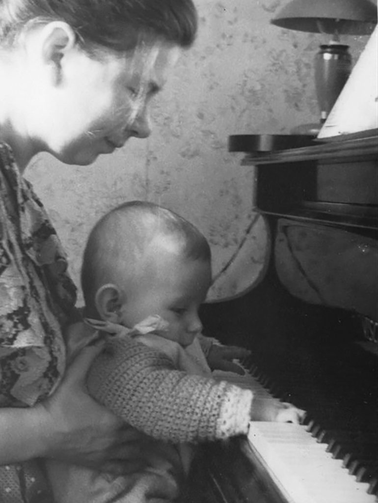 With mama at piano