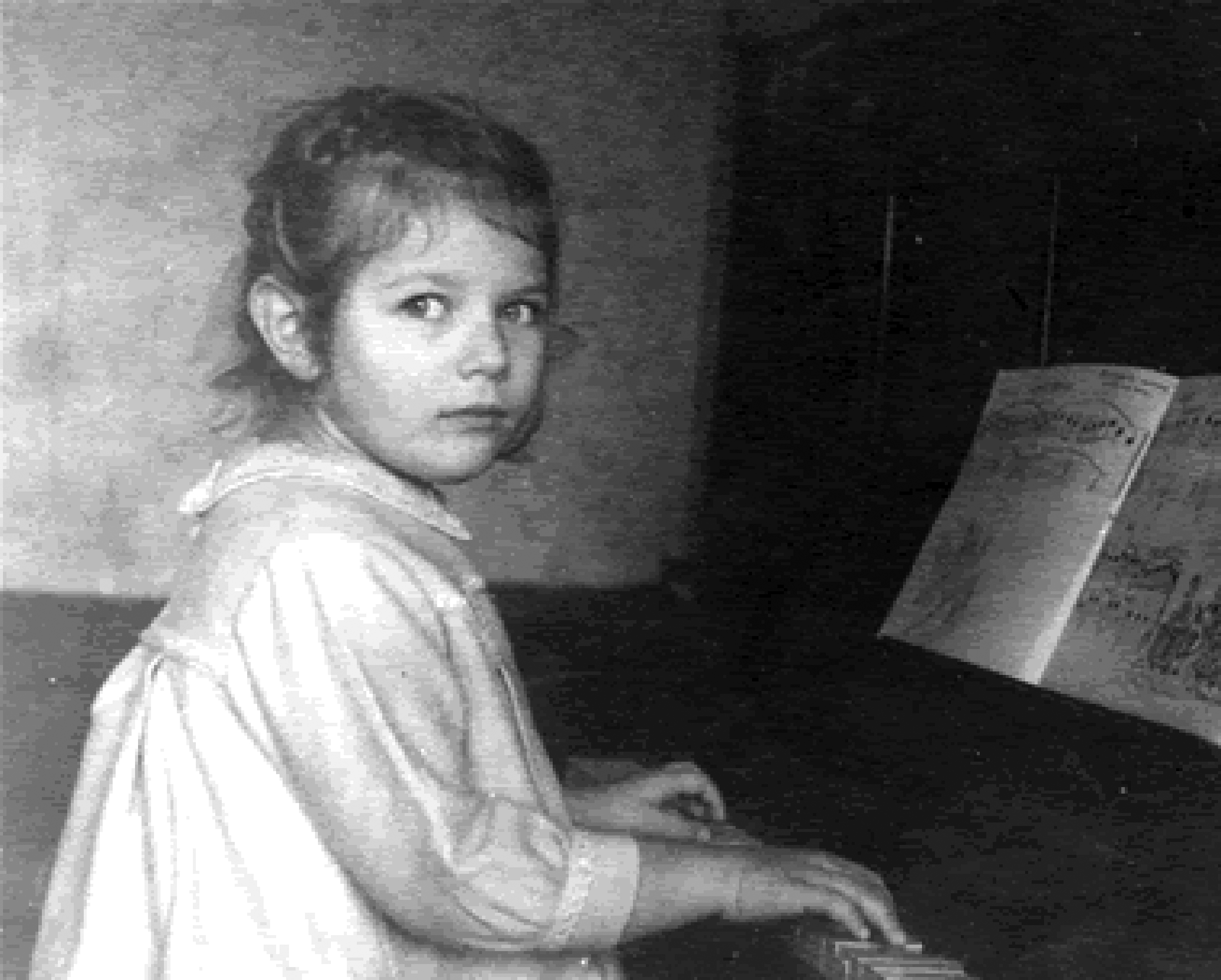 Yelena 5 years old at piano