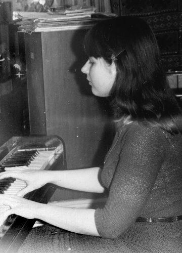 Yelena, 1982 playing piano