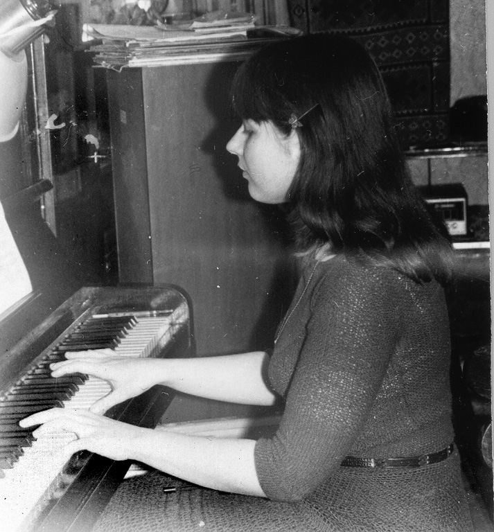 Yelena, 1982 playing piano