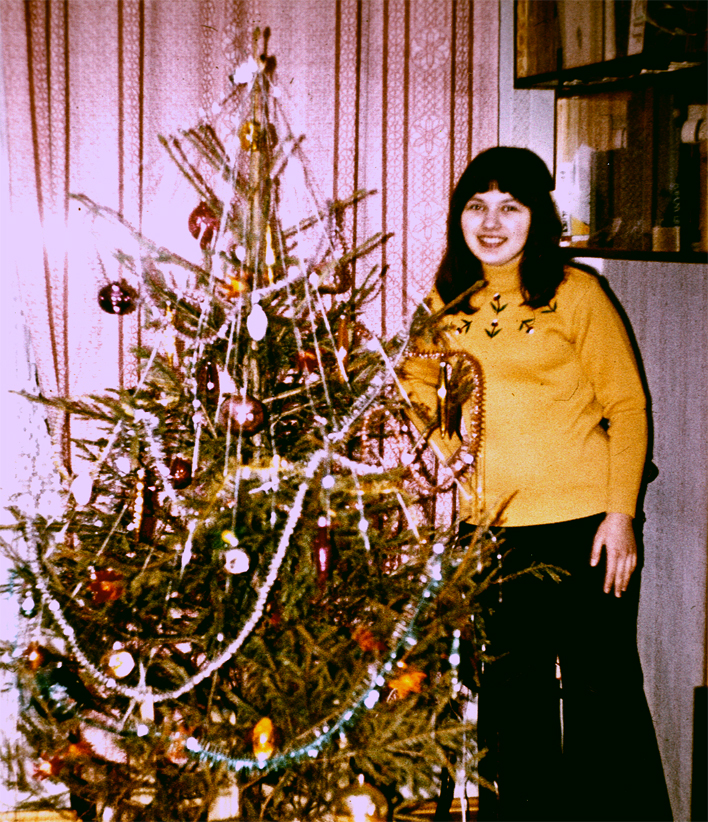 Yelena and Christmas tree, 76