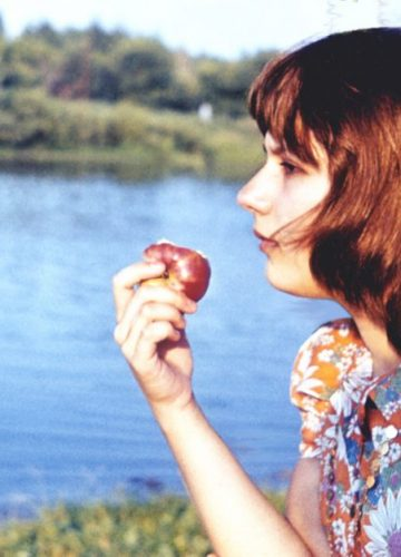 Yelena with an apple, 77